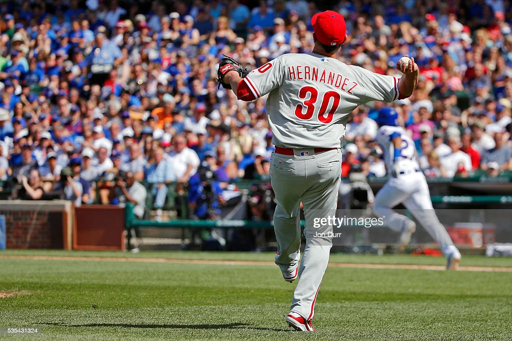 David Hernandez #30 of the Philadelphia Phillies throws to first base for the out on Addison Russell #27 of the Chicago Cubs during the seventh inning at Wrigley Field on May 29, 2016 in Chicago, Illinois.