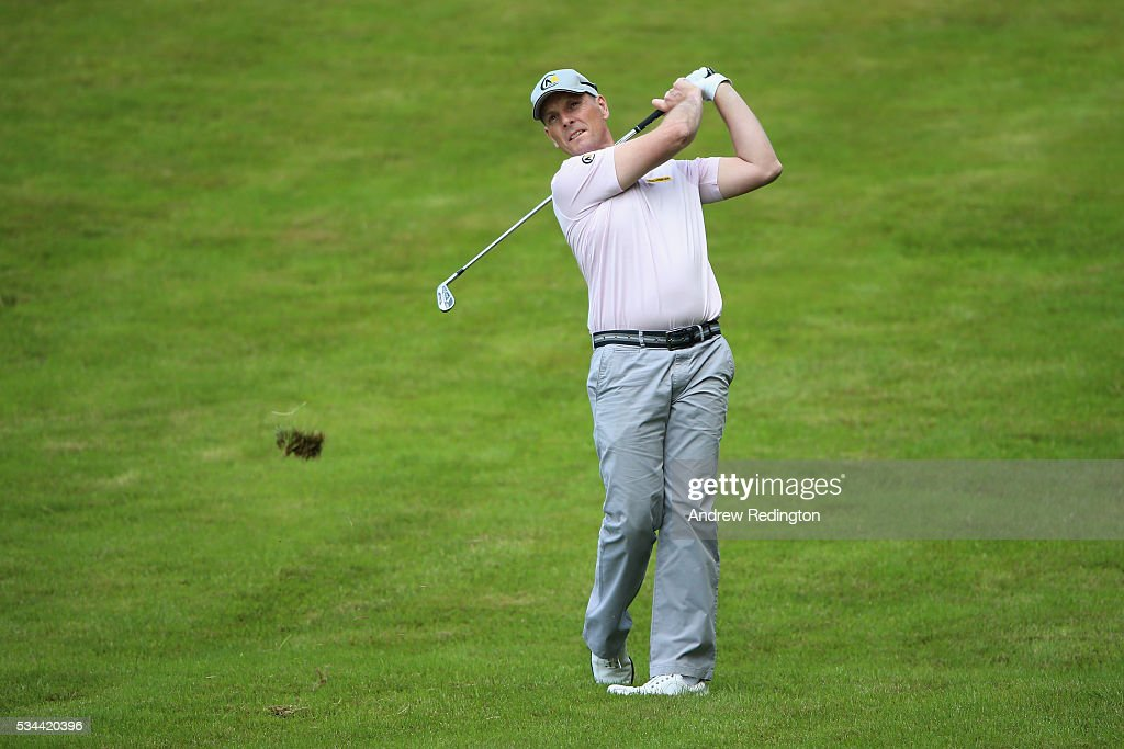 <a gi-track='captionPersonalityLinkClicked' href=/galleries/search?phrase=David+Higgins+-+Golfer&family=editorial&specificpeople=4523097 ng-click='$event.stopPropagation()'>David Higgins</a> of Ireland hits his 2nd shot on the 4th hole during day one of the BMW PGA Championship at Wentworth on May 26, 2016 in Virginia Water, England.