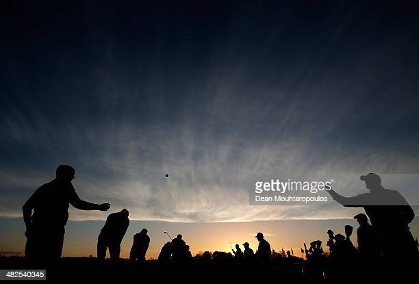 David Higgins of Ireland is thrown a ball by his caddie on the driving range prior to day two of the NH Collection Open held at La Reserva de...