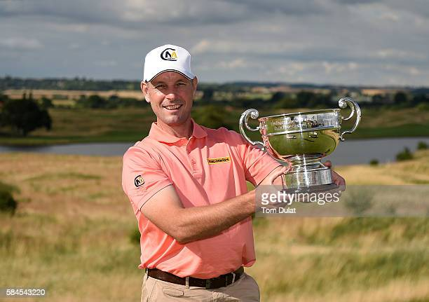 David Higgins of Waterville Golf Links poses with the trophy after winning the the PGA Professional Championship at The Oxfordshire Golf Club on July...