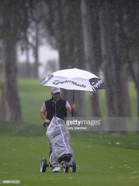 David Higgins of Waterville Golf Links shelters under an umbrella from the rain during the second round of the PGA PlayOffs at Antalya Golf Club PGA...