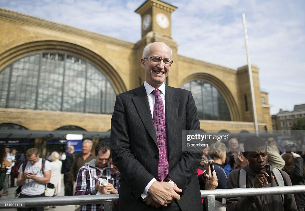 David Higgins, outgoing chief executive officer of Network Rail Ltd., poses for a photograph outside Kings Cross rail station in London, U.K., on Thursday, Sept. 26, 2013. Google Inc., owner of the world's largest search engine, won local government approval to build its new U.K. headquarters next to Kings Cross train station, which opened its new square today. Photographer: Simon Dawson/Bloomberg via Getty Images