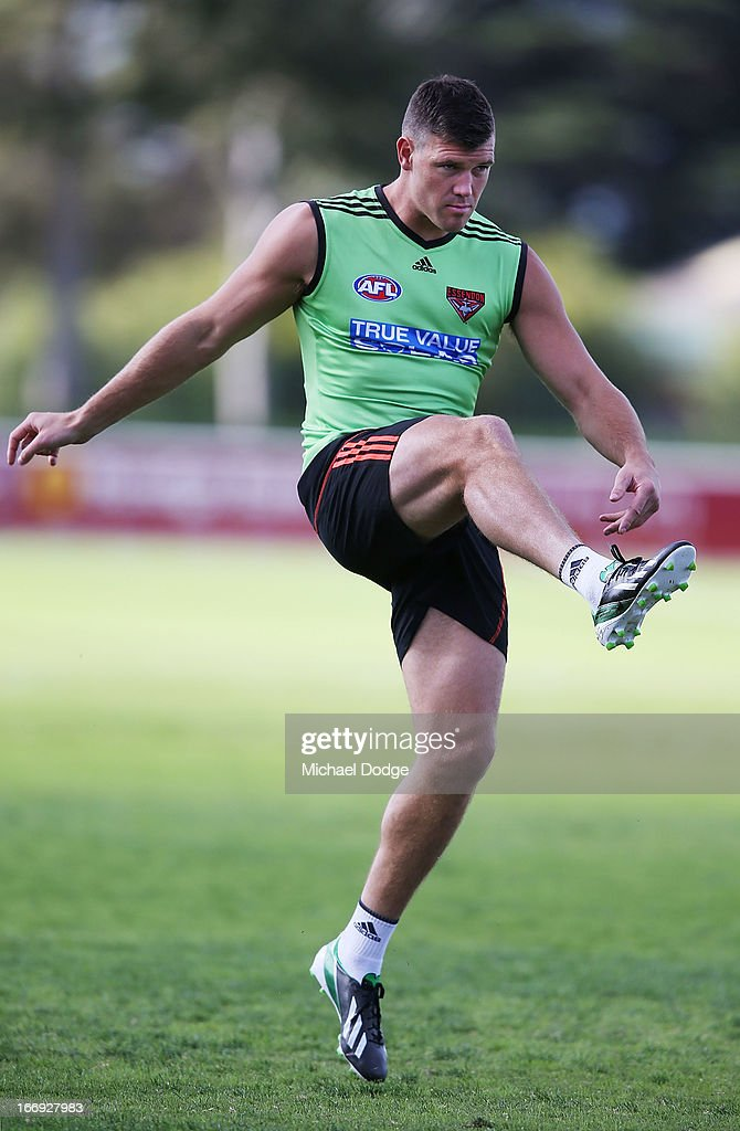 <a gi-track='captionPersonalityLinkClicked' href=/galleries/search?phrase=David+Hille&family=editorial&specificpeople=171320 ng-click='$event.stopPropagation()'>David Hille</a> of the Bombers kicks the ball during an Essendon Bombers AFL training session at Windy Hill on April 19, 2013 in Melbourne, Australia.
