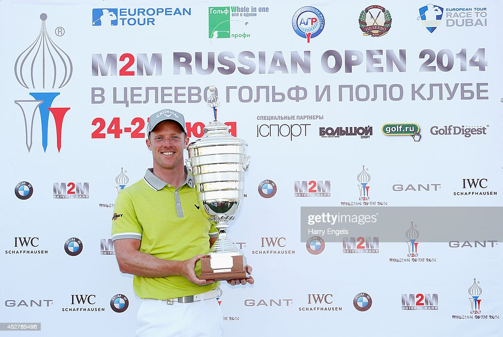 David Horsey of England celebrates with the trophy after winning the final round of the M2M Russian Open at Tseleevo Golf & Polo Club on July 27, 2014 in Moscow, Russia.