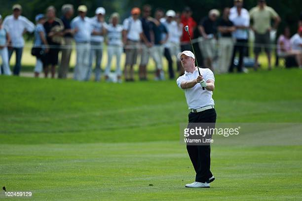David Horsey of England chips onto the 18th green during the final round of the BMW International Open at the Munich North Eichenried Golf Club on...