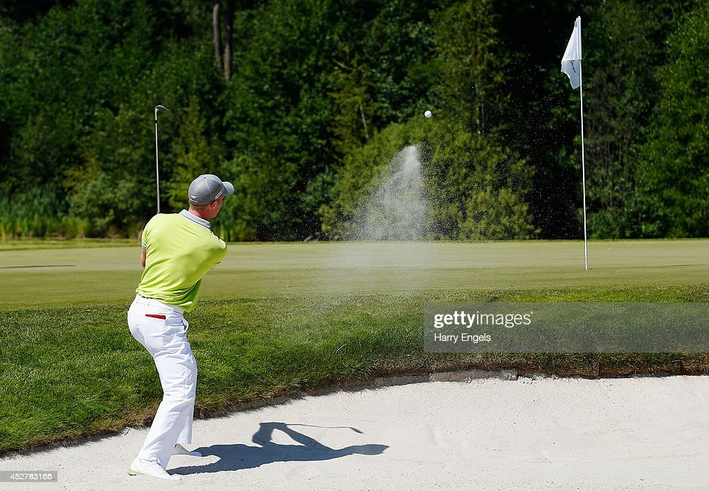 <a gi-track='captionPersonalityLinkClicked' href=/galleries/search?phrase=David+Horsey&family=editorial&specificpeople=776403 ng-click='$event.stopPropagation()'>David Horsey</a> of England chips out of a bunker at the eighth during the final round of the M2M Russian Open at Tseleevo Golf & Polo Club on July 27, 2014 in Moscow, Russia.