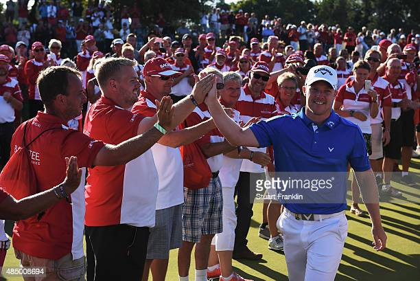 David Horsey of England greets the volunteers after winning the Made in Denmark at Himmerland Golf Spa Resort on August 23 2015 in Aalborg Denmark