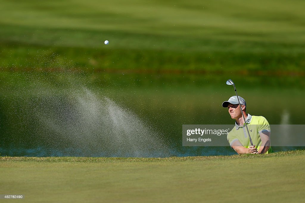 David Horsey of England hits out of a bunker at the eighteenth on day four of the M2M Russian Open at Tseleevo Golf & Polo Club on July 27, 2014 in Moscow, Russia.