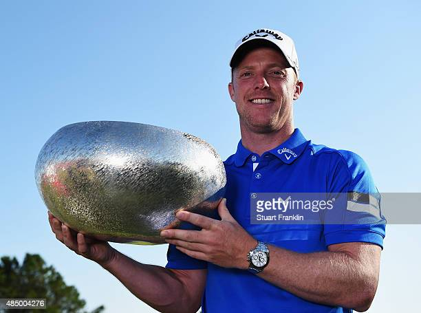 David Horsey of England holds the trophy after winning the Made in Denmark at Himmerland Golf Spa Resort on August 23 2015 in Aalborg Denmark