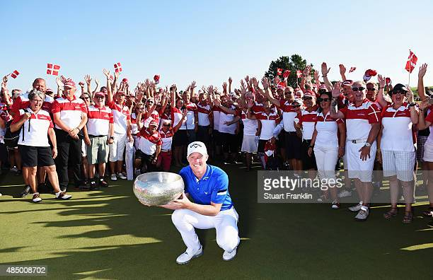 David Horsey of England holds the trophy with the volunteers after winning the Made in Denmark at Himmerland Golf Spa Resort on August 23 2015 in...