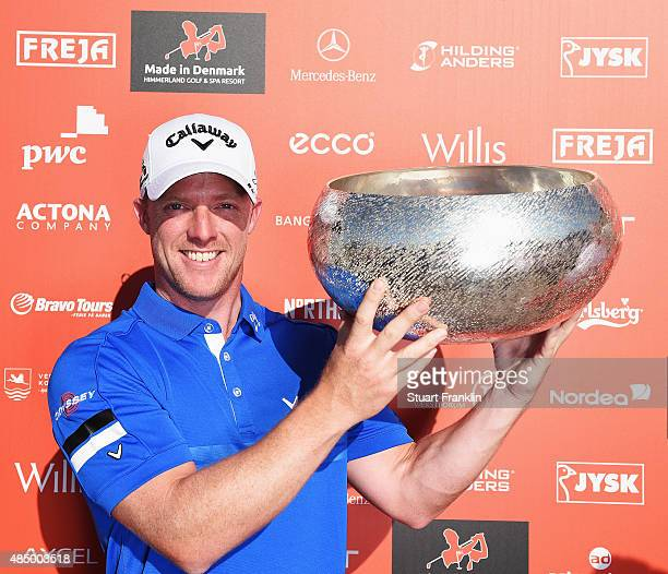 David Horsey of England jolds the trophy after winning the Made in Denmark at Himmerland Golf Spa Resort on August 23 2015 in Aalborg Denmark