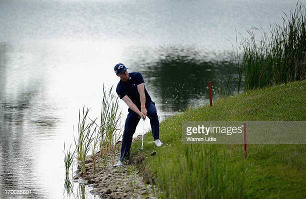 David Horsey of England plays from the waters edge on the 14th hole during the first round of the Lyoness Open powered by Greenfinity at Diamond...
