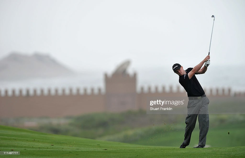 David Horsey of England plays his approach shot on the third hole during the final round of the Trophee du Hassan II Golf at the Golf du Palais Royal...