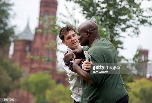 David Horton left teaches Marcus Green an Israeli style of selfdefense called Krav Maga on the Mall