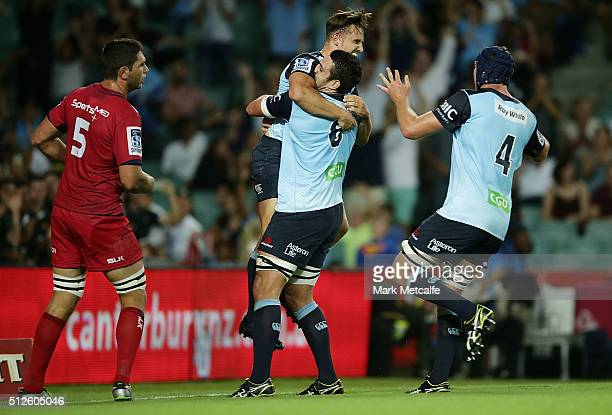 David Horwitz of the Waratahs celebrates scoring a try with team mates during the round one Super Rugby match between the Waratahs and the Reds at...
