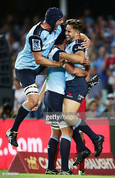 David Horwitz of the Waratahs celebrates with Dean Mumm and team mates after scoring a try during the round one Super Rugby match between the...