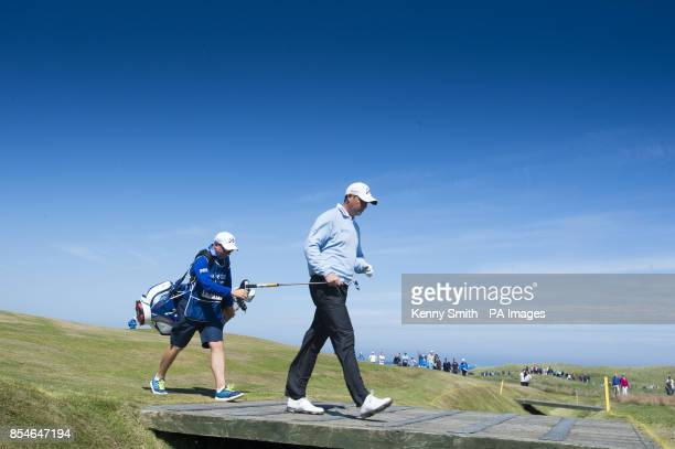 David Howell crosses a bridge on his way to the 14th green during day two of the Aberdeen Asset Management Scottish Open at Royal Aberdeen Aberdeen