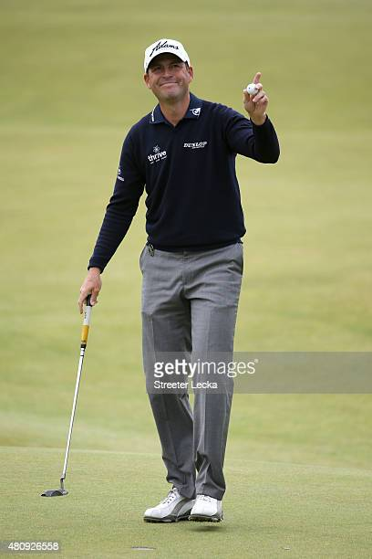 David Howell of England acknowledges the crowd on the 18th green during the first round of the 144th Open Championship at The Old Course on July 16...