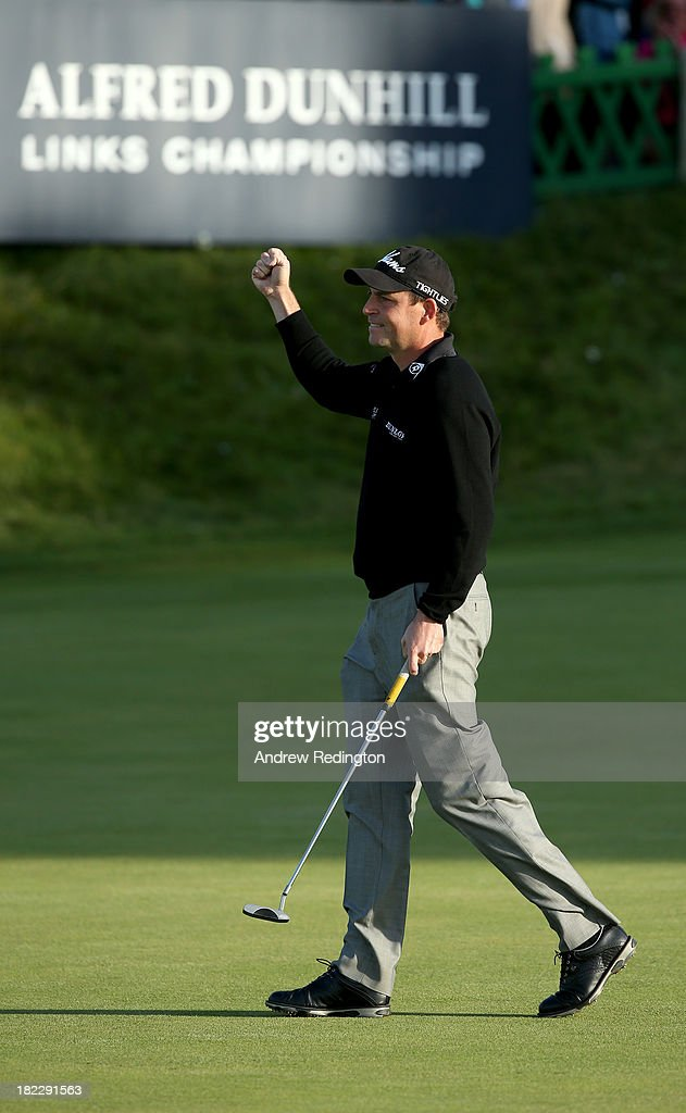 David Howell of England celebrates after holing his putt on the 18th green during the second playoff hole against Peter Uihlein of the USA during the final round of the Alfred Dunhill Links Championship on The Old Course, at St Andrews on September 29, 2013 in St Andrews, Scotland.