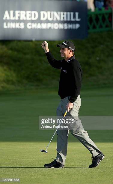 David Howell of England celebrates after holing his putt on the 18th green during the second playoff hole against Peter Uihlein of the USA during the...