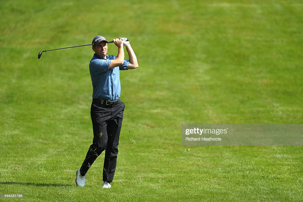 <a gi-track='captionPersonalityLinkClicked' href=/galleries/search?phrase=David+Howell&family=editorial&specificpeople=201681 ng-click='$event.stopPropagation()'>David Howell</a> of England hits an approach during day one of the BMW PGA Championship at Wentworth on May 26, 2016 in Virginia Water, England.