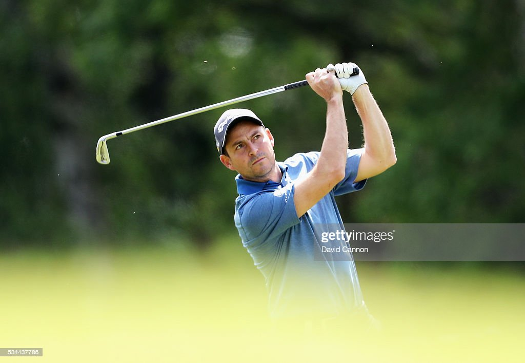 <a gi-track='captionPersonalityLinkClicked' href=/galleries/search?phrase=David+Howell&family=editorial&specificpeople=201681 ng-click='$event.stopPropagation()'>David Howell</a> of England hits his 2nd shot on the 9th hole during day one of the BMW PGA Championship at Wentworth on May 26, 2016 in Virginia Water, England.