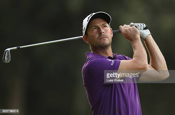 David Howell of England hits his second shot on the 13th hole during the first round of the BMW South African Open Championship at Glendower Golf...