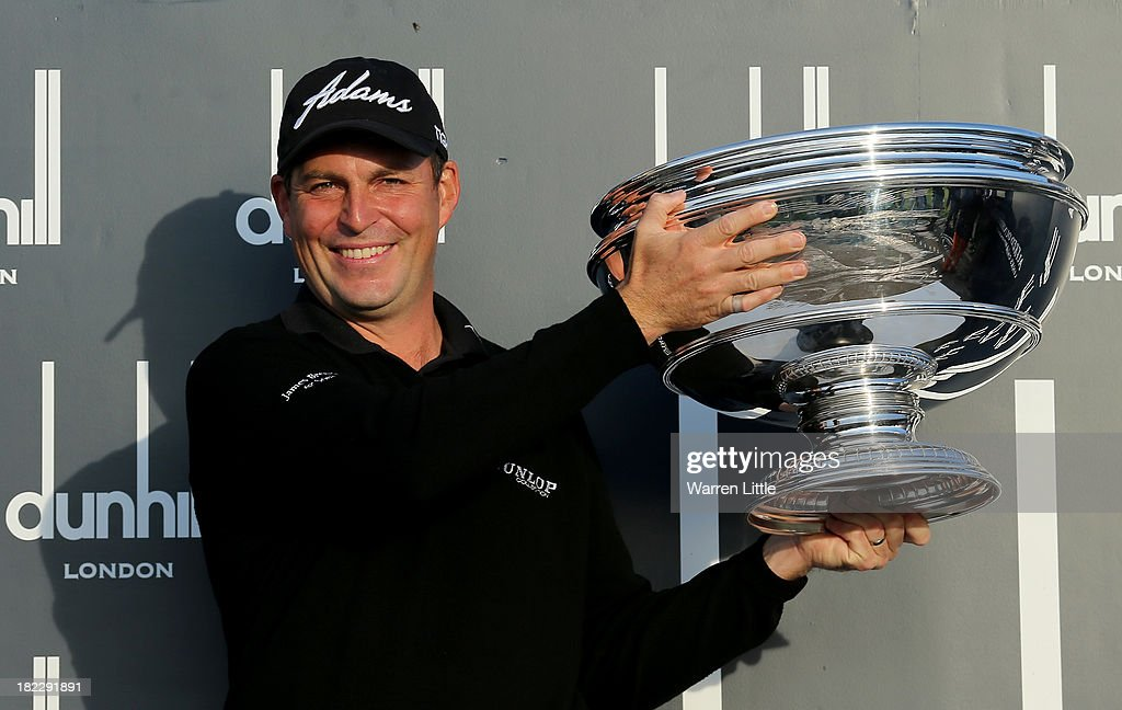 David Howell of England lifts the trophy aloft after victory at the Alfred Dunhill Links Championship on The Old Course, at St Andrews on September 29, 2013 in St Andrews, Scotland. Howell won after the second playoff hole against Peter Uihlein.