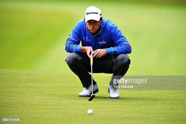 David Howell of England lines up a putt on the green on hole 2 on day one of the Aberdeen Asset Management Paul Lawrie Matchplay at Archerfield Links...