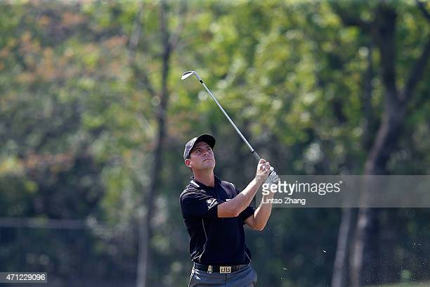 David Howell of England plays a shot during the day four of the Volvo China Open at Tomson Shanghai Pudong Golf Club on April 26 2015 in Shanghai...