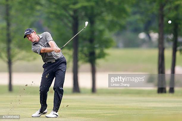 David Howell of England plays a shot during the day two of the Volvo China Open at Tomson Shanghai Pudong Golf Club on April 24 2015 in Shanghai China