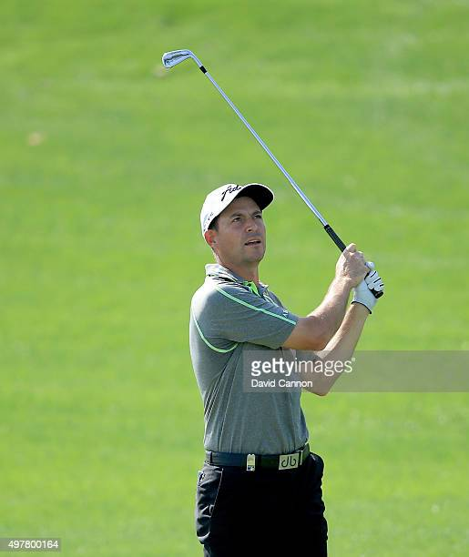 David Howell of England plays his second shot on the par 4 third hole during the first round of the 2015 DP World Tour Championship on the Earth...