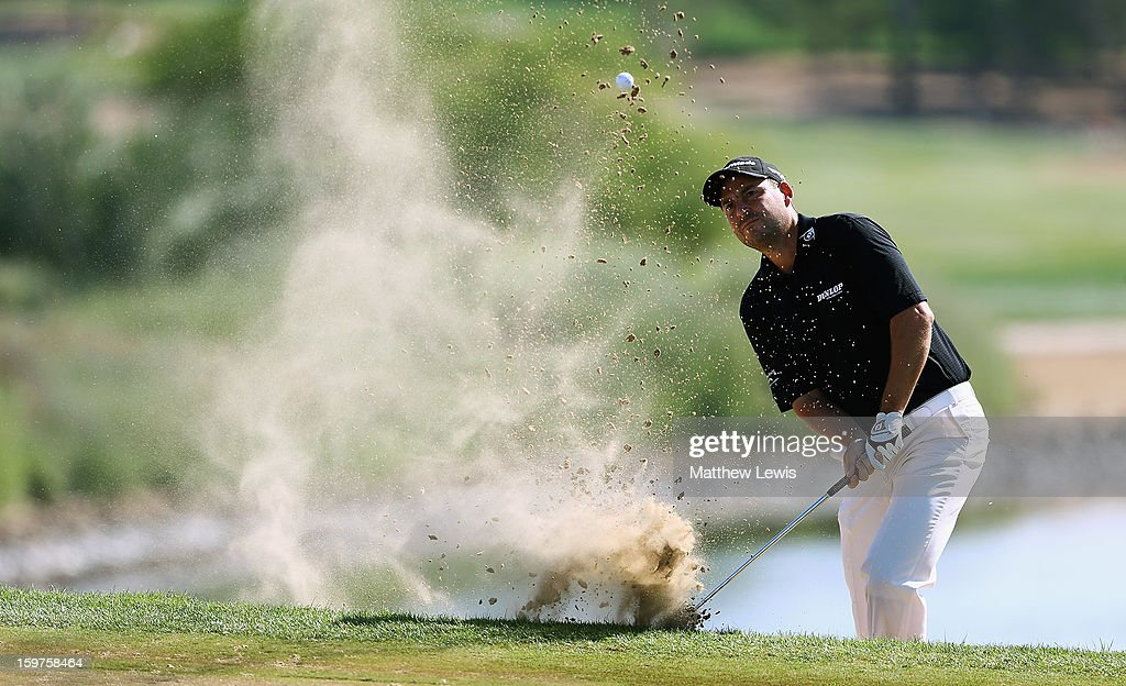 <a gi-track='captionPersonalityLinkClicked' href=/galleries/search?phrase=David+Howell&family=editorial&specificpeople=201681 ng-click='$event.stopPropagation()'>David Howell</a> of England plays out of a bunker on the 7th hole during day four of the Abu Dhabi HSBC Golf Championship at Abu Dhabi Golf Club on January 20, 2013 in Abu Dhabi, United Arab Emirates.