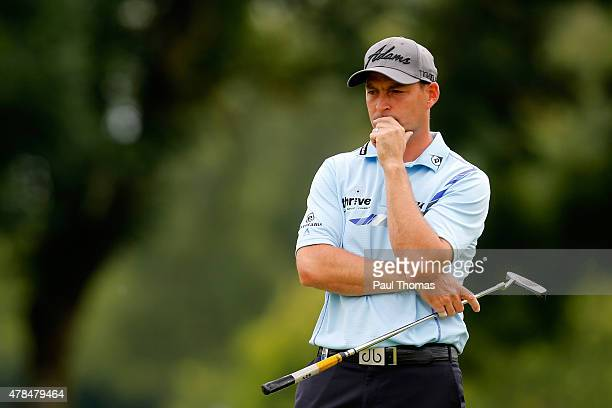 David Howell of England watches on during the BMW International Open day one at the Eichenried Golf Club on June 25 2015 in Munich Germany