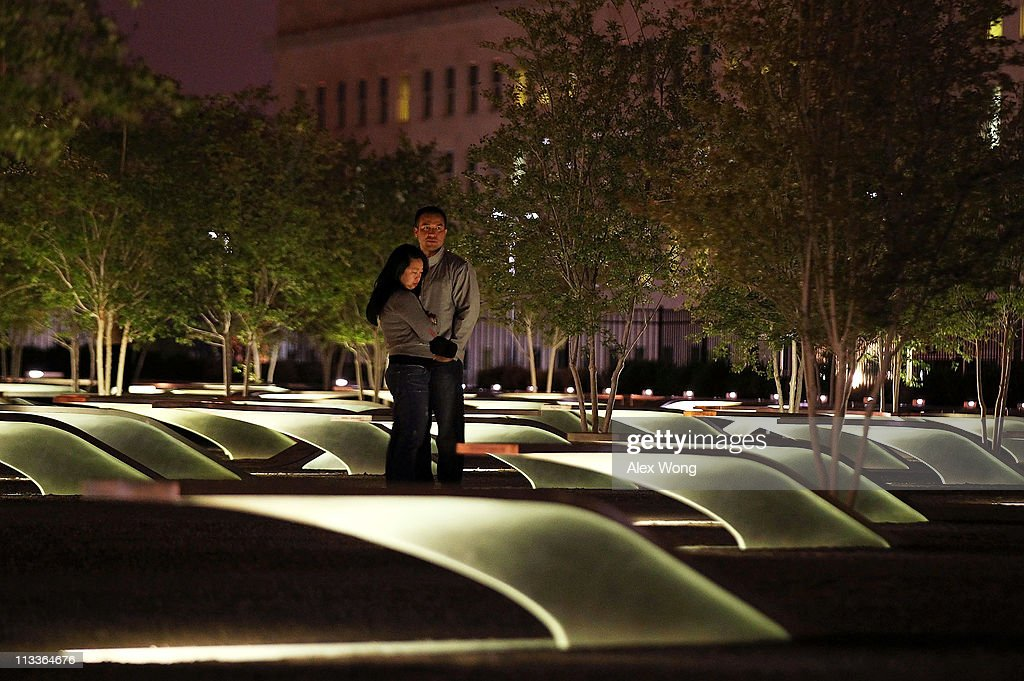 David Huber and Nicole Lozare of Arlington, Virginia, pay their respect to victims of the 9/11 terrorist attacks in the early morning of May 2, 2011, after President Barack Obama has announced the death of Osama Bin Laden, at the Pentagon Memorial outside the Department of Defense (Pentagon) in Arlington, Virginia. A special force led operation has killed Osama Bin Laden in a house outside Islamabad in Pakistan and his body is in U.S.'s custody.
