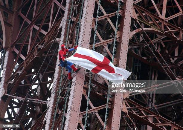 David Hulme the chief rigger on Blackpool Tower flying the cross of St George for the England football team as he scales the 420 foot landmark...