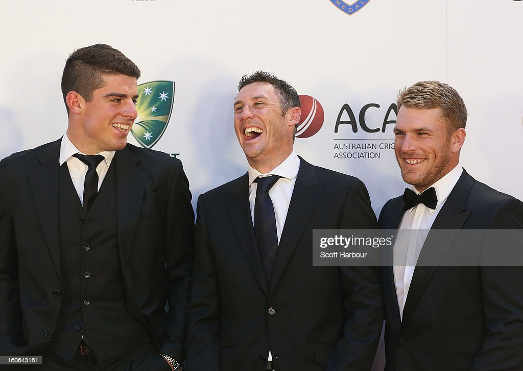 David Hussey (C) and Aaron Finch (R) of Australia arrive during the 2013 Allan Border Medal awards ceremony at Crown Palladium on February 4, 2013 in Melbourne, Australia.
