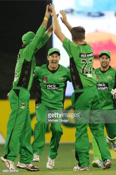 David Hussey C celebrates a wicket by Jackson Bird of the Stars after dismissing Tom Cooper of the Renegades during the Big Bash League match between...