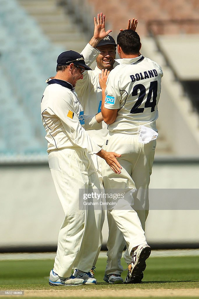 David Hussey, Cameron White and Scott Boland of the Bushrangers celebrate after Boland bowled out Nathan Reardon of the Bulls during day four of the Sheffield Shield match between the Victorian Bushrangers and the Queensland Bulls at Melbourne Cricket Ground on February 21, 2013 in Melbourne, Australia.