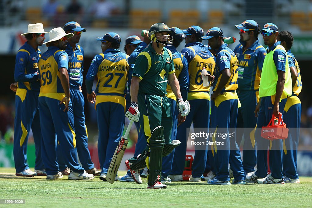 David Hussey of Australia walks from the ground after he was dismissed during game three of the Commonwealth Bank One Day International Series between Australia and Sri Lanka at The Gabba on January 18, 2013 in Brisbane, Australia.