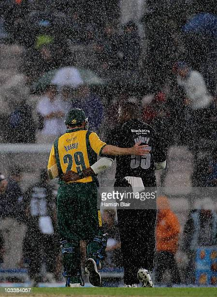 David Hussey of Nottinghamshire and Kieron Pollard of Somerset leave the field together as rain ends the match during the Friends Provident T20 Semi...