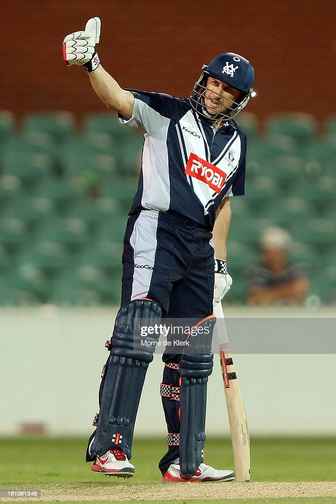 <a gi-track='captionPersonalityLinkClicked' href=/galleries/search?phrase=David+Hussey&family=editorial&specificpeople=193810 ng-click='$event.stopPropagation()'>David Hussey</a> of the Bushrangers gestures during the Ryobi One Cup Day match between the South Australian Redbacks and the Victorian Bushrangers at Adelaide Oval on February 9, 2013 in Adelaide, Australia.