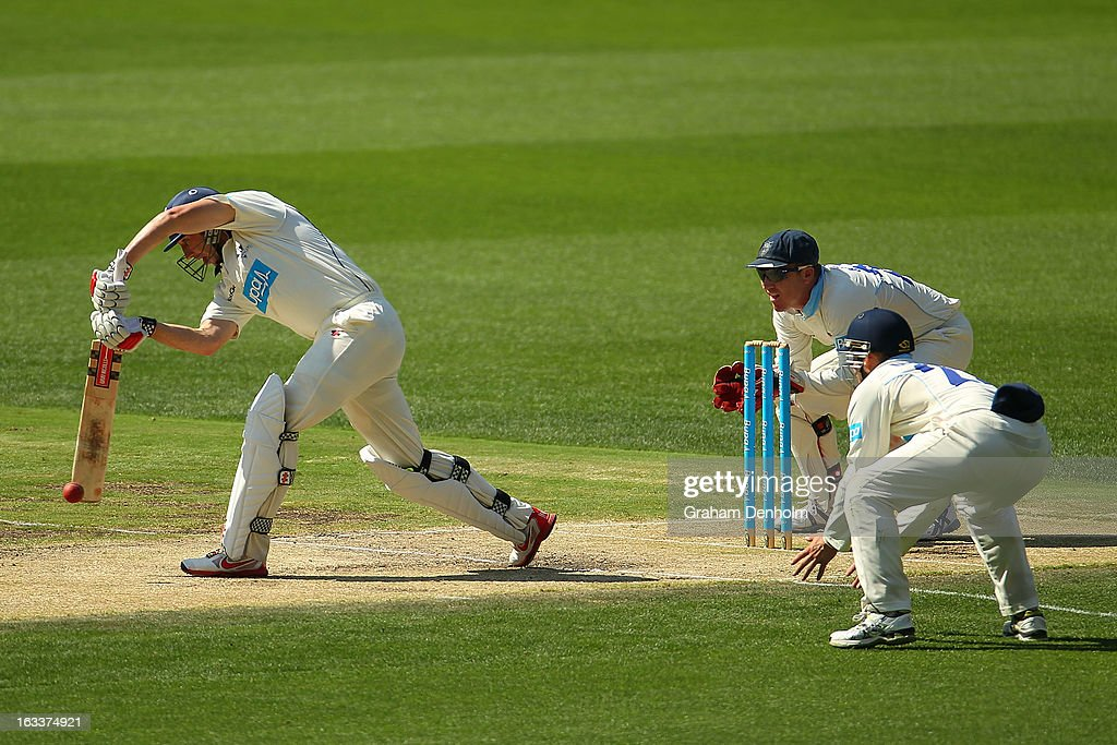 David Hussey of the Bushrangers (L) plays a shot during day three of the Sheffield Shield match between the Victorian Bushrangers and the New South Wales Blues at Melbourne Cricket Ground on March 9, 2013 in Melbourne, Australia.