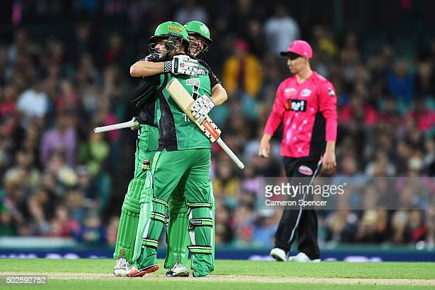 David Hussey of the Stars celebrates with team mate Tom Triffitt after Triffitt hit the winning runs during the Big Bash League match between the...