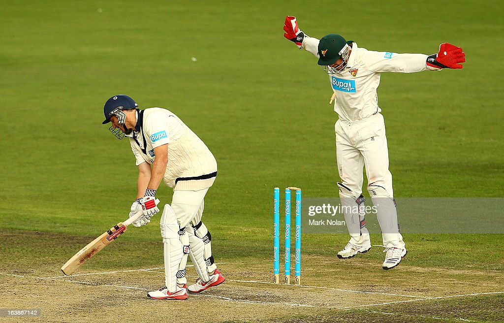 David Hussey of Victoria is bowled by James Faulkner of the Tigers during day four of the Sheffield Shield match between the Tasmania Tigers and the Victoria Bushrangers at Blundstone Arena on March 17, 2013 in Hobart, Australia.