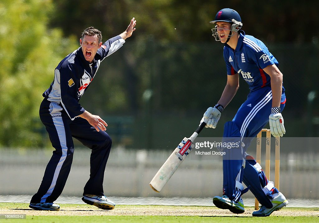 David Hussey of Victoria reacts next to Craig Overton of the England Lions after getting a wicket during the International tour match between the Victorian 2nd XI and the England Lions at Junction Oval on February 7, 2013 in Melbourne, Australia.
