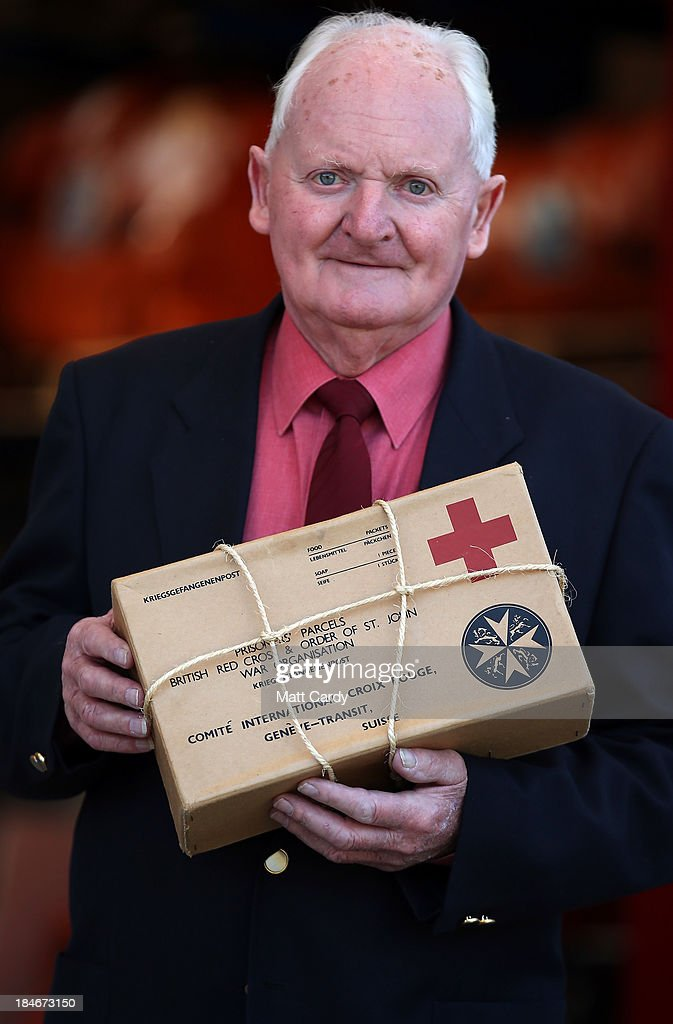 David Isherwood holds a replica Red Cross parcel similar to the ones he received as a boy, outside the Red Cross Bristol Emergency Response Unit Warehouse, to mark the 150th anniversary of The Red Cross movement on October 15, 2013 in Bristol, England. The 80-year-old Channel Islands resident - who as a survivor of the German occupation during WW2 was kept alive by food parcels he received - travelled to the British Red Cross Bristol Emergency Response Unit to celebrate the 25 million food parcels issued worldwide by the British Red Cross.