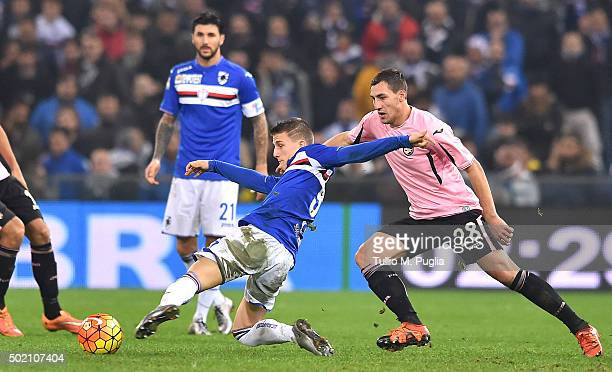 David Ivan of Sampdoria and Mato Jajalo of Palermo compete for the ball during the Serie A match between UC Sampdoria and US Citta di Palermo at...