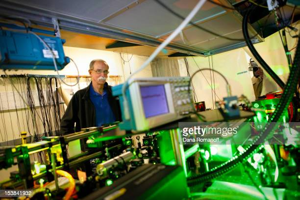 David J Wineland a physicist at the US Department of Commerce's National Institute of Standards and Technology gives media a tour of his lab after...