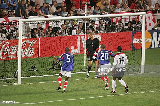 David James can only watch as Zinedine Zidane scores from the penalty during the France v England Group B match in the 2004 UEFA European Football...